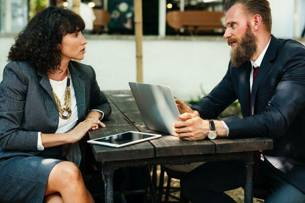 Two-people-discussing-sales