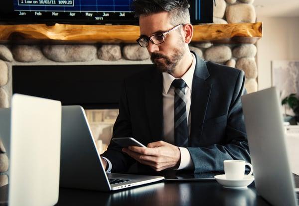 adult-businessman-using-tablet-laptop-sales