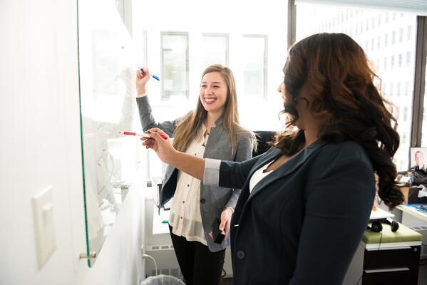 employees-at-board-discussing-a portrait-of-the-overperforming-salesperson