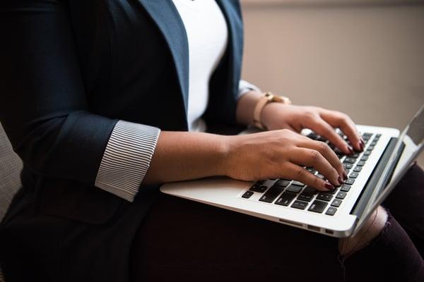 businesswoman-typing-on-laptop