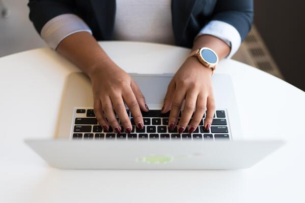 businesswomen-typing-on-laptop-1