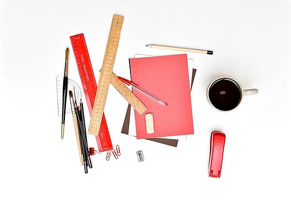 messy-desk-with-red-items-on-top