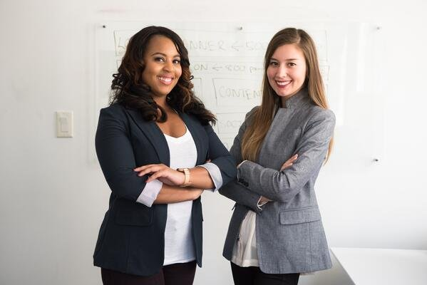 two-smiling-salespeople