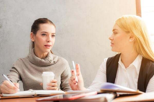 two-women-discussing-why-customers-dont-buy
