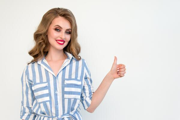 women-adult-giving-thumbs-up-in-blue-and-white-striped-dress
