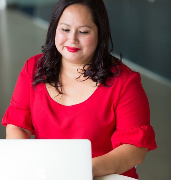 women-in-red-dress-working-on-laptop